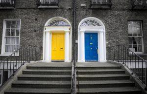 Bright blue door next to bright yellow door