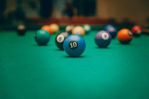 billiard balls on a green pool table